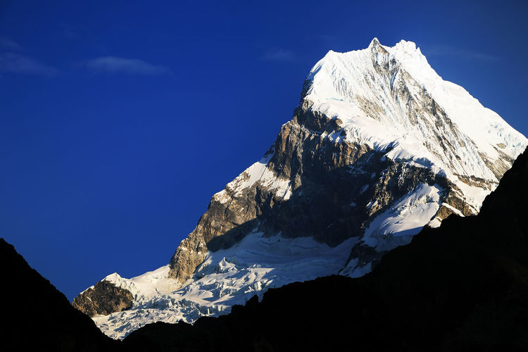 Snowcapped Mountain Peak Against Sky