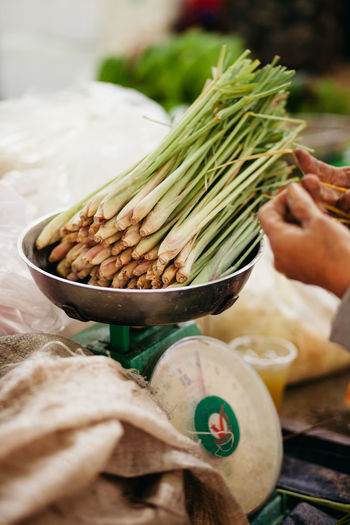 Close-up of scallions on weight scale in market for sale