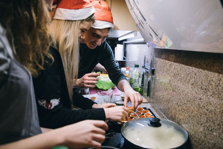 Food Stories Real People Food And Drink Holding Women Lifestyles Togetherness Food People Adult Indoors  Preparation  Two People Kitchen Friendship Home Casual Clothing Females Bonding Domestic Room Leisure Activity Preparing Food Cooking Christmas
