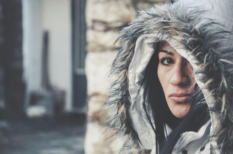 Close-Up Portrait Of Beautiful Woman Wearing Fur Hood