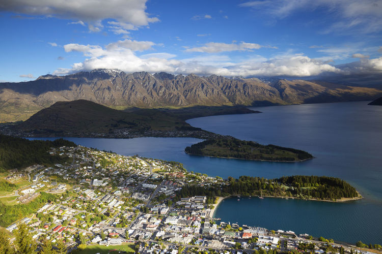 A vivid view of Queenstown with blue sky, beautiful lake and mountains. Beauty In Nature Cloud - Sky Day Lake Landscape, Travel, People, Freedom, Mountain, View, Adventure, Journey, Tourism, Backpack, Trip, Nature, Hill, Tourist, Top, Snow, Outdoor, Beautiful, Clouds, Peak, Valley, Wanderlust, Lifestyle, Explore, Scenic, Lake, Relaxing, Leisure, Sky, Mountains, M Mountain Mountain Range Nature No People Outdoors Scenics Sky Tranquility Water