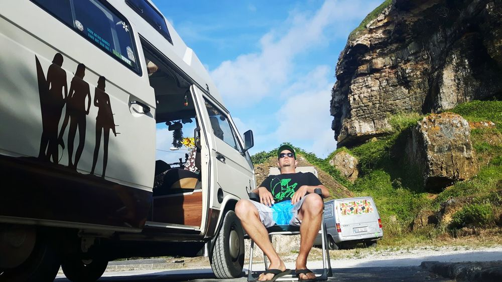 Sitting Adult Outdoors Mode Of Transport Travel Destinations People Day Men One Person Portugal Summer Eat Sleep Surf Van Life Roadtrip Volkswagenbus Vacations Portugal 🇵🇹 Beach