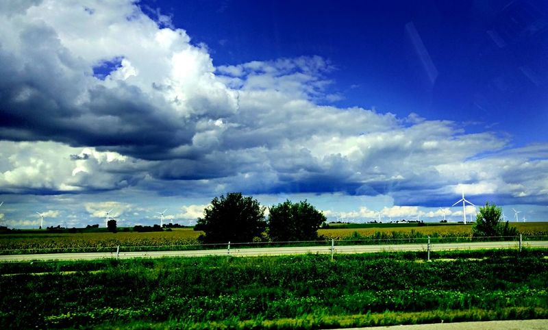By The Side Of The Road Moody Sky Cloudy Day Windmills Farmland Driving Through End Of Summer Blue Sky