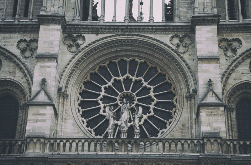 Paris Architecture Built Structure Building Exterior Travel Destinations Building Place Of Worship Belief Religion The Past History Spirituality Art And Craft No People Arch Low Angle View Rose Window Gothic Style Ornate