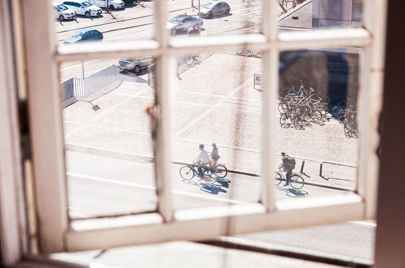 High angle view of bicycle on glass window