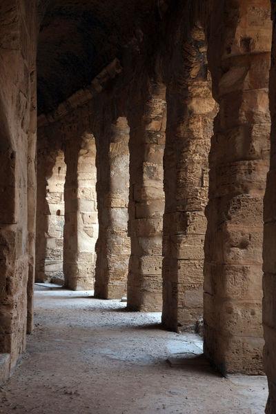 The amphitheater in El Jem, Tunisia Built Structure Abandoned Africa Amphitheater Ancient Arches Arena Arhitecture Building Exterior El Jem Empire Erosion Famous Place Gladiator Heritage History Landmark Old Ruin Roman Ruined Stone Stone Travel Destinations Tunisia Unesco
