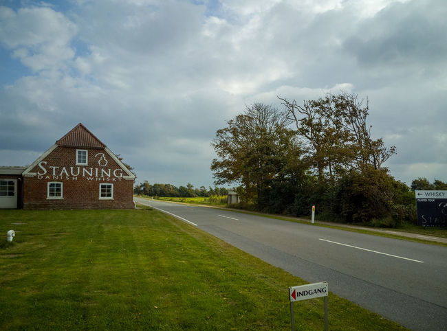 Architecture Building Building Exterior Built Structure Cloud - Sky Day Grass Green Color House Landscape Nature No People Outdoors Plant Residential District Road Sign Sky Transportation Tree
