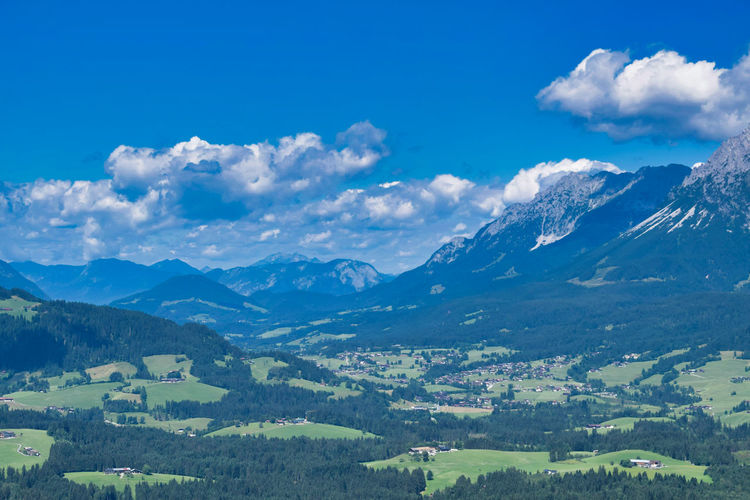 Scenic view of mountains against blue sky