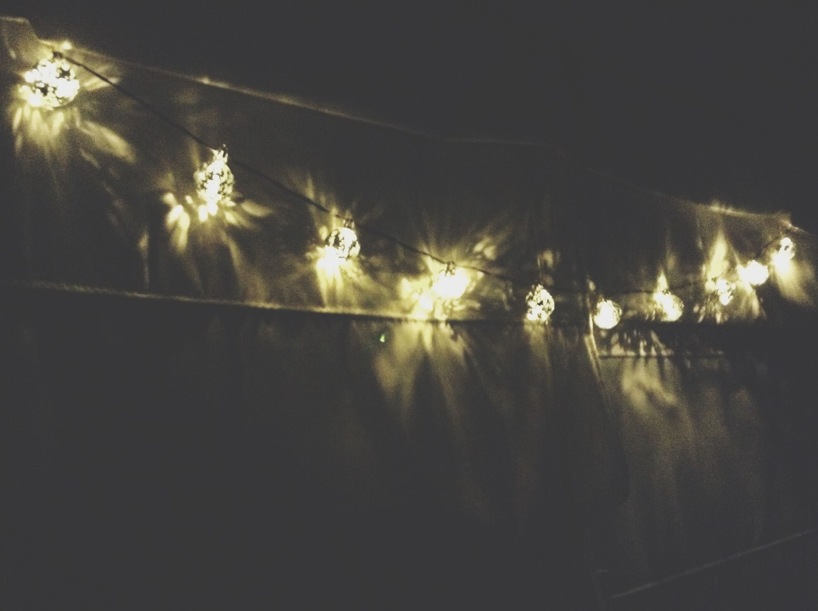 illuminated, night, lighting equipment, reflection, indoors, glowing, dark, water, light - natural phenomenon, no people, decoration, copy space, hanging, lit, nature, light, electricity, celebration, electric light