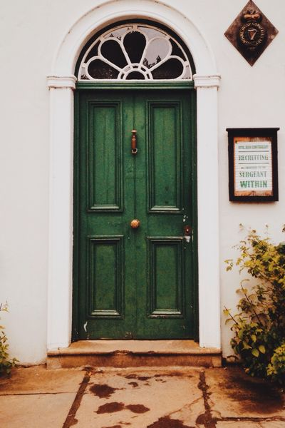 Georgian door Door Closed Building Exterior Built Structure Focus On Foreground Vibrant Color The Way Forward House Entrance Residential Structure Residential Building Green Color Arch Front Door Day Green Entry Outdoors Façade Entryway