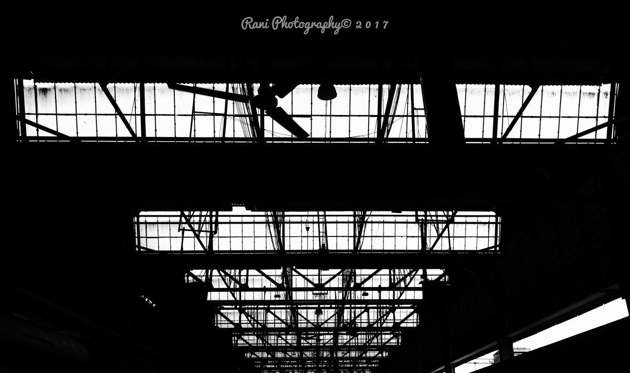 indoors, low angle view, built structure, architecture, silhouette, day, men, real people, one person, people