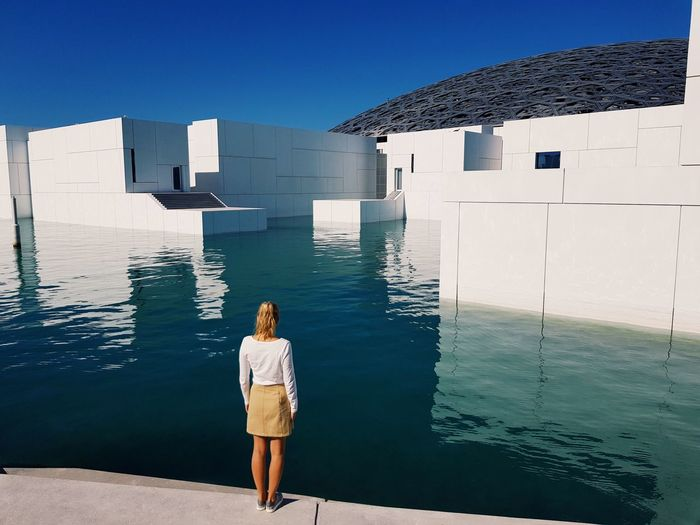 Standing by the water Minimalist Architecture Abu Dhabi Louvre Rear View Architecture Real People Water Built Structure Sea One Person Standing Building Exterior Young Adult