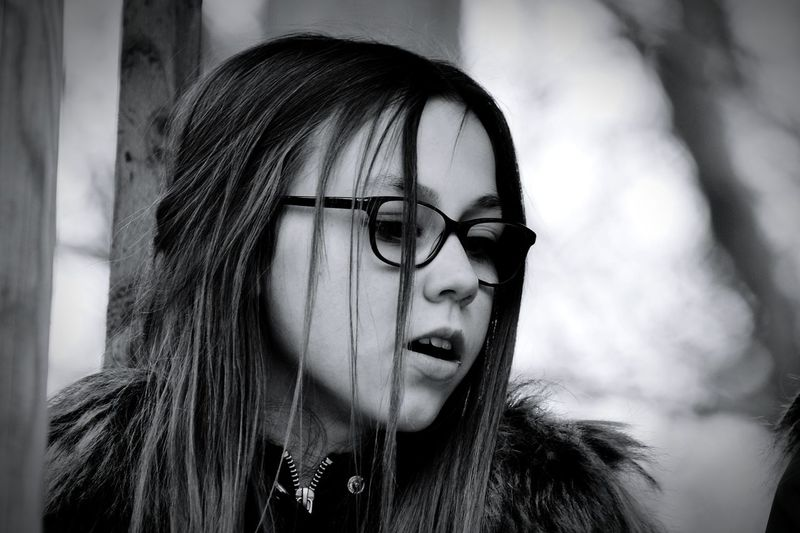 Thoughtful girl wearing eyeglasses looking away