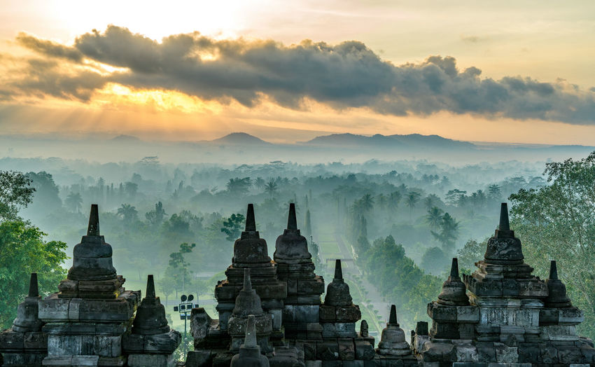 ASIA Ancient Borobudur Temple Bright Far East INDONESIA Java Ancient Civilization Ancient Ruins Borobudur Buddhism Clouds Hazy  Heritage History Light And Shadow No People Rays Studio Shot Sun Beams Sunrise Temple Viewpoint