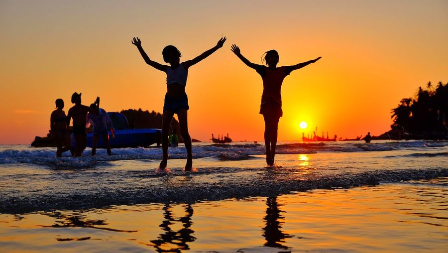 Happy time holiday Sunset Beach Silhouette Water Happiness Fun Vacations Sand Adult Summer Celebration Enjoyment Dusk People Day Holiday♡ Time Passing Jumping Orange Color Lifestyles Boat Beauty In Nature Togetherness Mountain