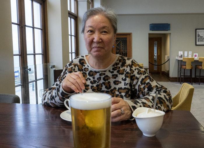 Behind the beer