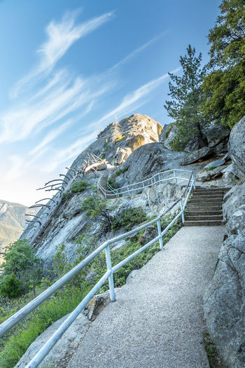 Sequoia National Park, Moro Rock California National Park Sequoia National Park The Great Outdoors - 2018 EyeEm Awards USA Architecture Beauty In Nature Built Structure Cloud - Sky Day Formation Low Angle View Moro Rock Mountain Nature No People Non-urban Scene Outdoors Plant Rock Rock - Object Rock Formation Scenics - Nature Sky Solid Stone Wall Tranquil Scene Tranquility Tree