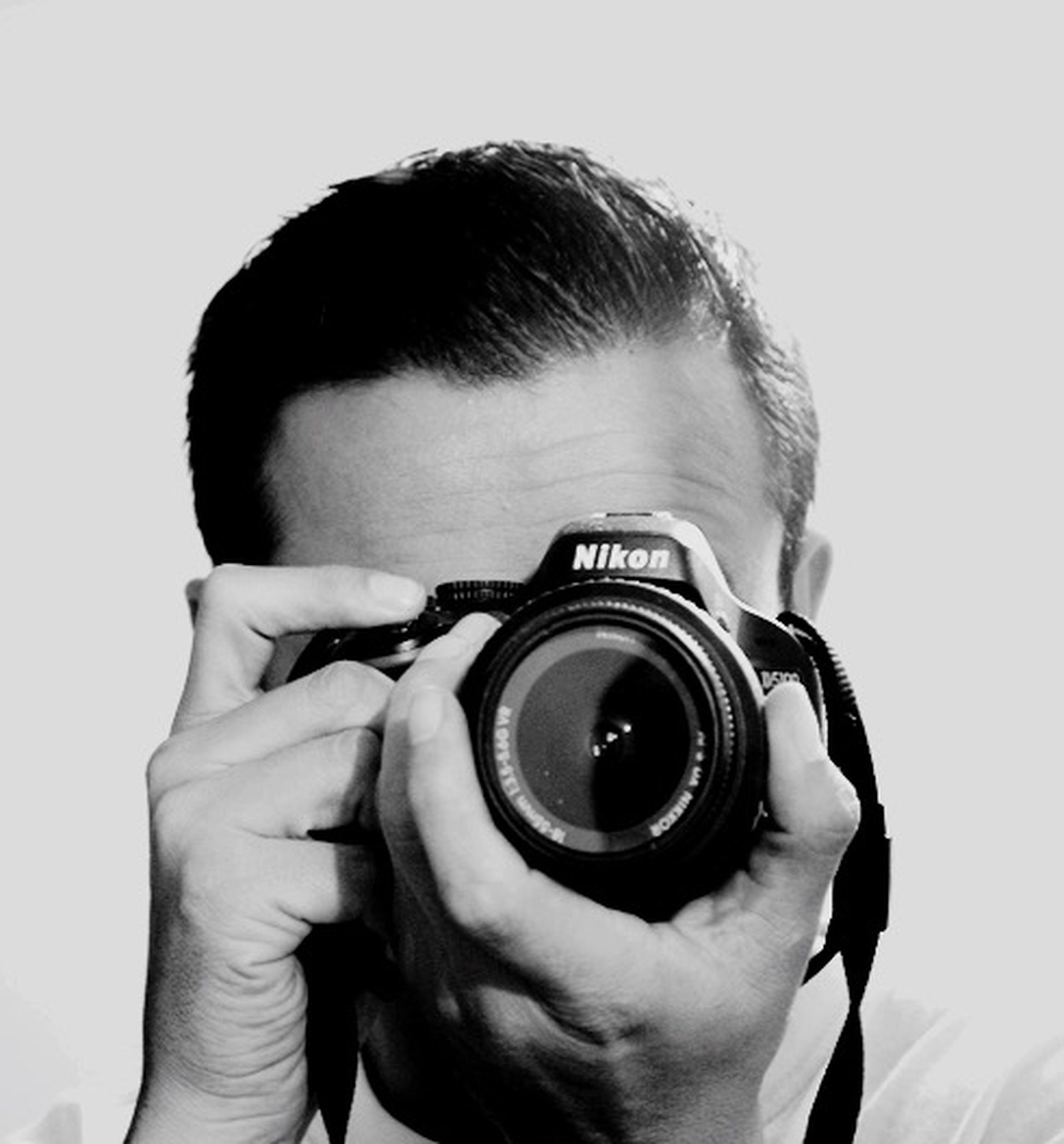 lifestyles, holding, photography themes, leisure activity, photographing, camera - photographic equipment, technology, person, men, digital camera, headshot, sunglasses, close-up, smart phone, young adult, young men, camera