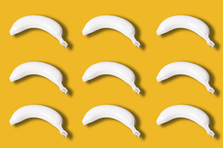 many white colored bananas isolated on yellow background Bananas Many White Isolated Yellow Color Background View Top Colored Abstract Fresh Healthy Natural Food Fruit Ripe Delicious Snack Dessert Nutrition Freshness Diet Concept Vitamin Gourmet Organic Plant Tropical Creative Whole Nature Art Nutritious Layout Design Breeding Macro Style Peel Skin Sweet Pattern Bright Lay Vegetarian Tasty Above Raw Idea