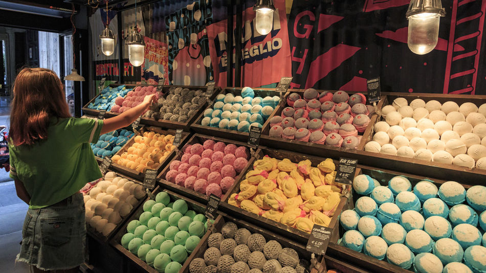 Rome, Italy - June 13, 2018: Young girl buying a bath bomb in a store in Rome, Italy Coliseum Quirinale Rome Viminale Bath Bombs Beauty Europe Fori Romani Helth Italy Trevi