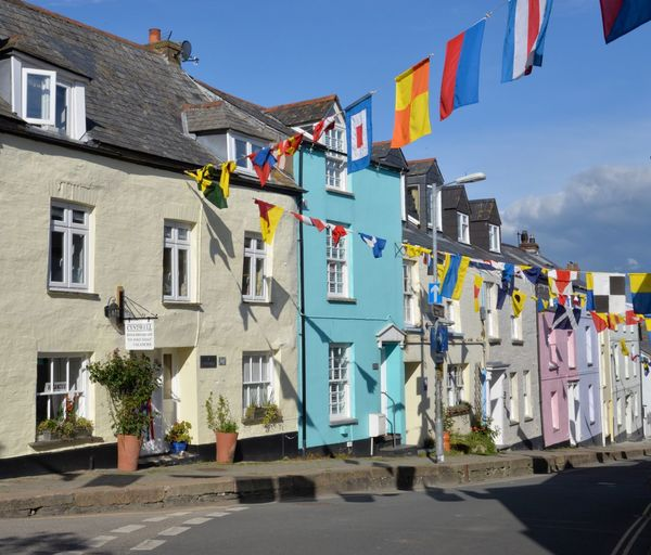 Put out the flags Happy Colourful Obby Oss Day Decorated Street Celebration Bunting Coloured Cottages Padstow Town Cornwall Cornish Cottages Building Exterior Built Structure Architecture Building Sky Multi Colored Hanging No People Outdoors Flag Window Cloud - Sky Low Angle View Street Sunlight Day