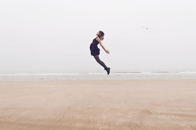 Fresh On Eyeem  Sand VSCO Ocean Sky Selfportrait Peaceful Flying Floating Shades Of Winter Full Length Vitality Beach Athleticism Agility Adult One Person Sea Flexibility Jumping Outdoors Love Yourself Go Higher Visual Creativity #FREIHEITBERLIN