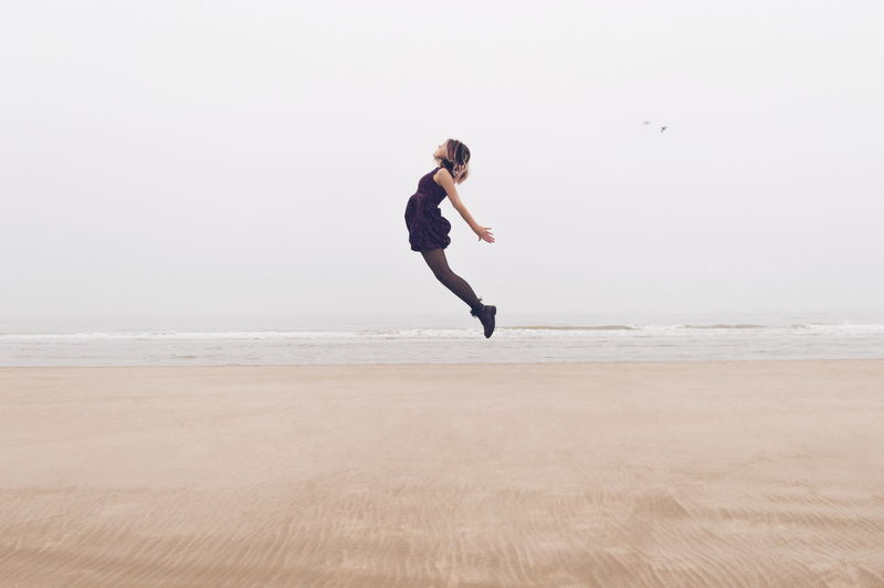 Fresh On Eyeem  Sand VSCO Ocean Sky Selfportrait Peaceful Flying Floating Shades Of Winter Full Length Vitality Beach Athleticism Agility Adult One Person Sea Flexibility Jumping Outdoors Love Yourself Go Higher Visual Creativity #FREIHEITBERLIN The Creative - 2018 EyeEm Awards The Great Outdoors - 2018 EyeEm Awards
