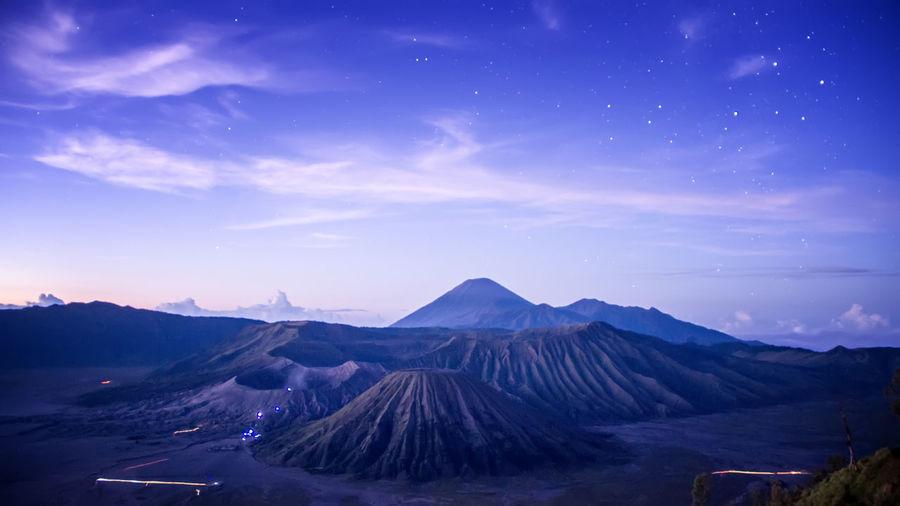Volcanic landscape against blue sky