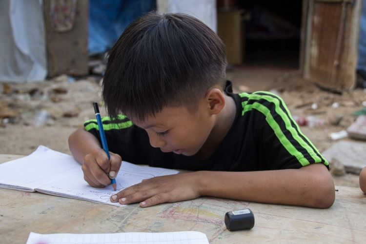 Boys Childhood Drawing Elementary Age Focus On Foreground Freshness Innocence Kid Leisure Activity Looking Down Outdoor Outdoor Photography Paying Attention Person Study Hard Studying Working Hard