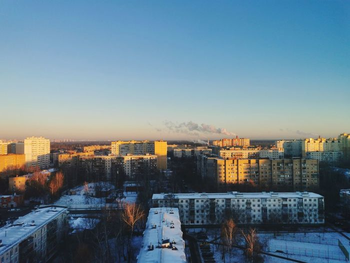 High angle view of buildings against sky during winter