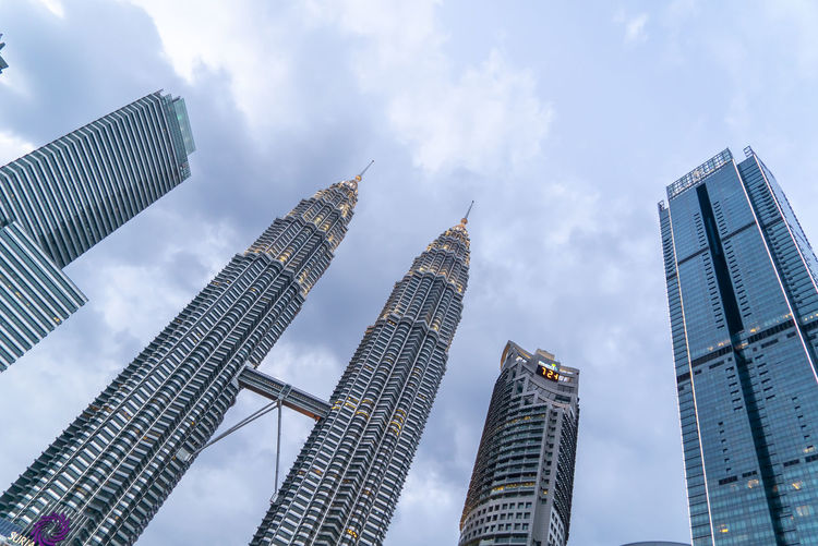 Sunset at Petronas Twin Towers KLCC, Kuala Lumpur Architecture Built Structure Building Exterior Office Building Exterior City Building Tall - High Sky Skyscraper Low Angle View Cloud - Sky Tower Modern Office Travel Destinations No People Nature Financial District  Landscape Outdoors Cityscape Spire