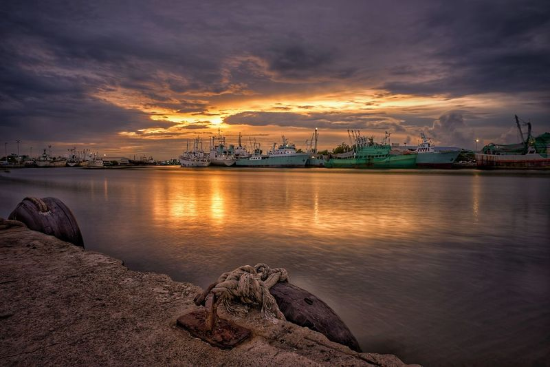 Water Sea Sunset Nautical Vessel Beach Reflection Mountain Cityscape Dusk Dramatic Sky Low Tide Romantic Sky Seascape Bay Of Water TOWNSCAPE Fishing Boat Harbor Moody Sky