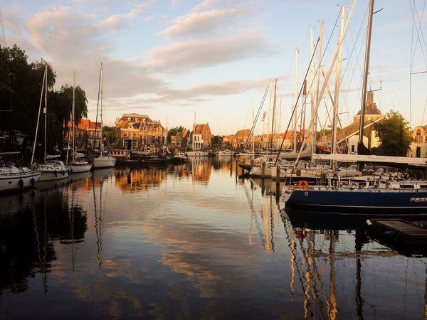 Beautiful sunset in Holland Nautical Vessel Water Sky Sailboat Architecture Sunset Sunlight Warm Light Sailing Evening Summer Photography Holland First Eyeem Photo EyeEmNewHere
