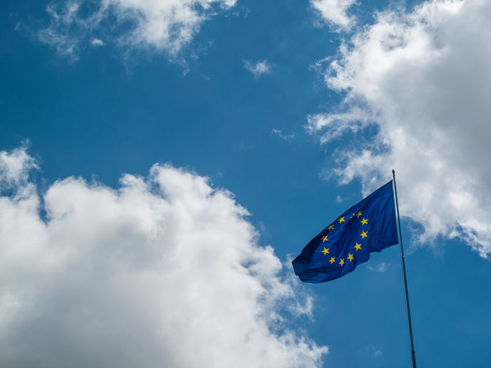 Low Angle View Of European Union Flag Cloudy Sky