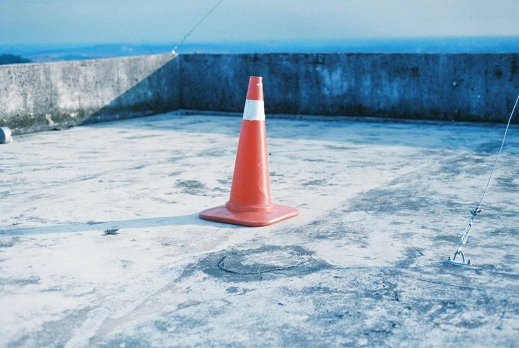 safety cone EyeEmNewHere Close-up Communication Cone Day Guidance Horizon Over Water Nature No People Outdoors Protection Red Road Safety Sea Security Sign Sky Traffic Cone Transportation Water