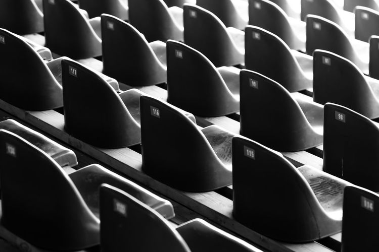Empty seatings Bench Auditorium B&w Backgrounds Black And White Chair Close-up Day Empty Full Frame In A Row Indoors  Large Group Of Objects No People Numbers Pattern Repeating Repetition Seat Seating Stadium