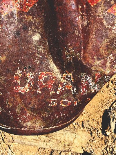 """""""Orange Soda"""" The only identifier remaining in time. New Mexico Photography New Mexico Dirt Trash Orange Soda Old Can Rusty Rust Discarded Outdoors Close-up Field Textured"""