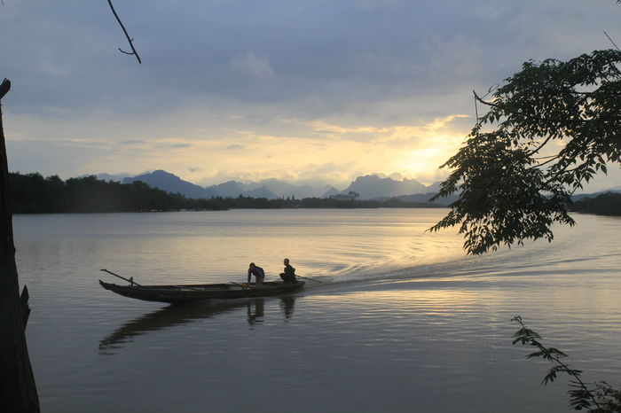 riverside in hometown Beauty In Nature Day Lake Leisure Activity Men Nature Nautical Vessel Oar Outdoors People Real People Rowing Scenics Silhouette Sitting Sky Standing Sunset Togetherness Tree Two People Water