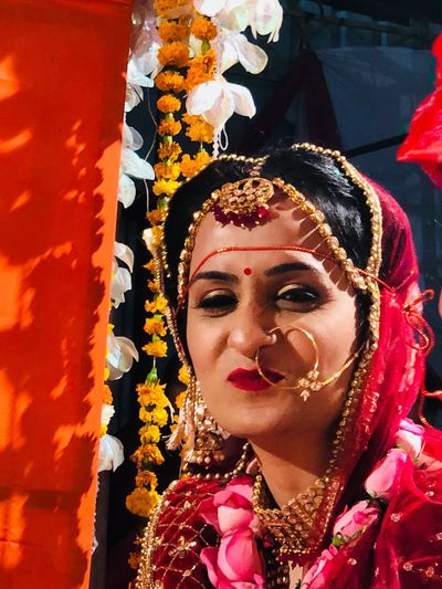 Close-up portrait of smiling young bride during wedding ceremony