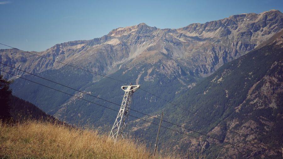 Mountains landscape with cableway trellis - vintage style photo