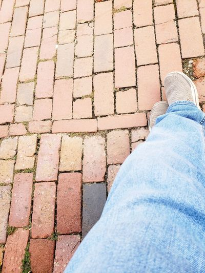 Brick Walk Designs Sketchers Shoes Brick Brick Pavers Low Section Human Leg Personal Perspective High Angle View Jeans Men Close-up Stone Tile Ground Shoe Paving Stone Paved Denim Footwear