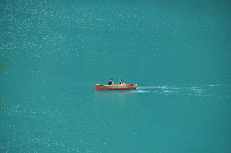 People on boat in sea