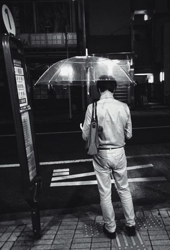 RainyDay Lonely Commute Public Transportation Umbrella Businessman Blackandwhite Desaturated People And Places