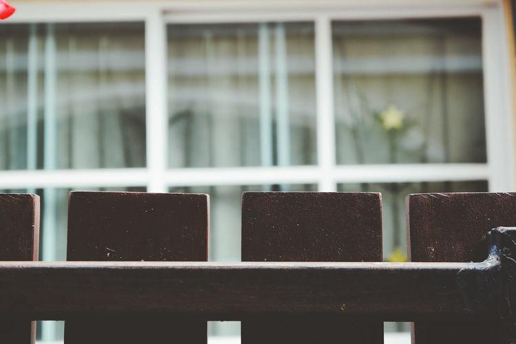 Close-up of railing against building