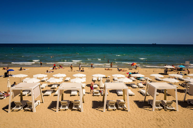 People On Sunny Beach In Spain