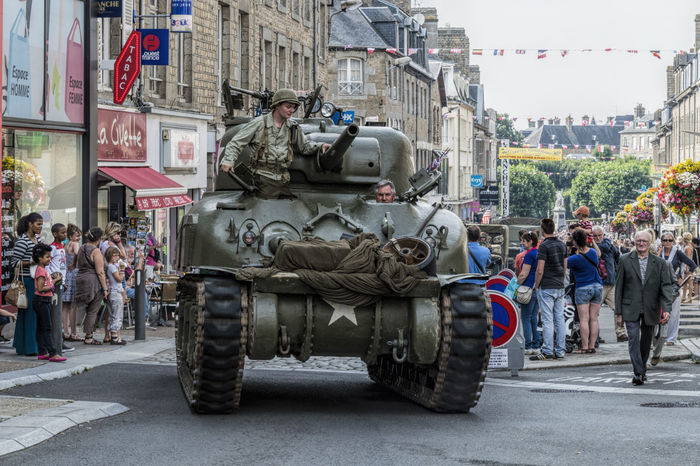 Military parade conmemorating battle of Normandy Architecture Armour Battle Building Exterior Built Structure City City Life Commémoration Crowd Day Group Of People Large Group Of People Men Militar Military Normandy Outdoors Parade Patton Person Sherman Street Tank Vehicle World War 2