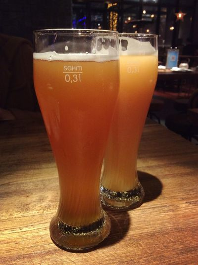 Close-up of beer glass on table
