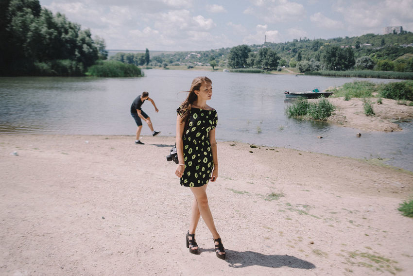 From the Left Bank series. Ekaterina and Alexander walking along the river. Ribnita, Transnistrian Region, Republic of Moldova. Documentary The Photojournalist - 2017 EyeEm Awards