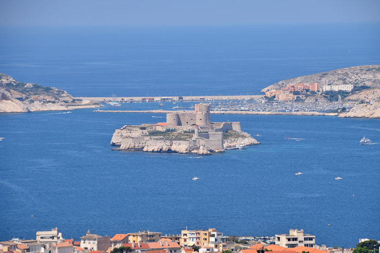 View of Marseille marine and port with the Chateau d'If Chateau D'if Outdoors Cityscape TOWNSCAPE Travel Destinations Scenics - Nature Travel High Angle View Day Sky Building City Nature Land No People Built Structure Blue Building Exterior Water Sea Architecture Castle Island Famous Place Landmark