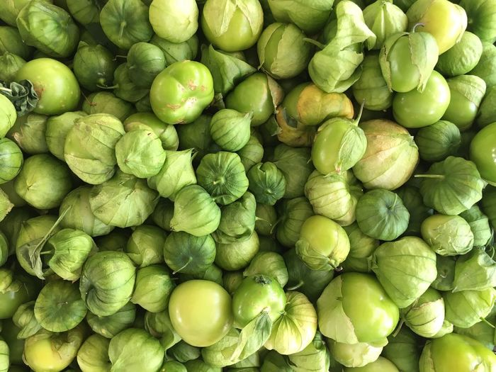 Full Frame Shot Of Tomatillos In Market For Sale